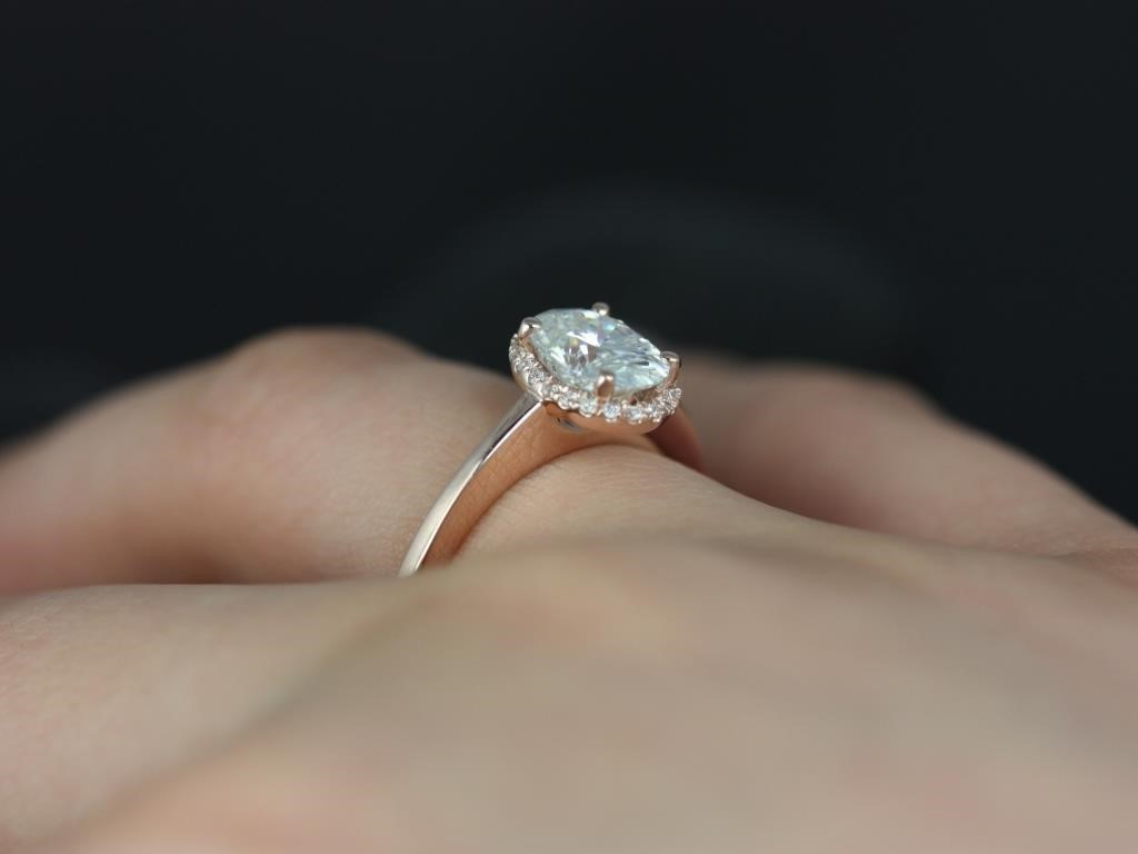 yellow gold engagement rings on finger