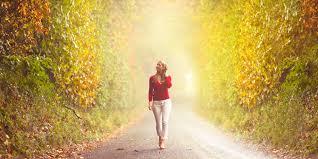 woman walking down sunny path
